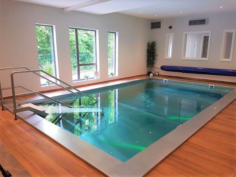 A stainless steel hydrotherapy pool installed into the ground